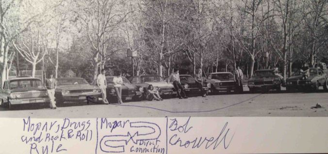 A partial gathering of the PASM Association, the Palo Alto Street Machine Association. Photo taken by yearbook staff in1979. I was on the yearbook staff that year, so I made sure we got this photo in. Too bad one of my friends decided it was cool too draw over it with his pen. Location, the back parking lot of Palo Alto High School.